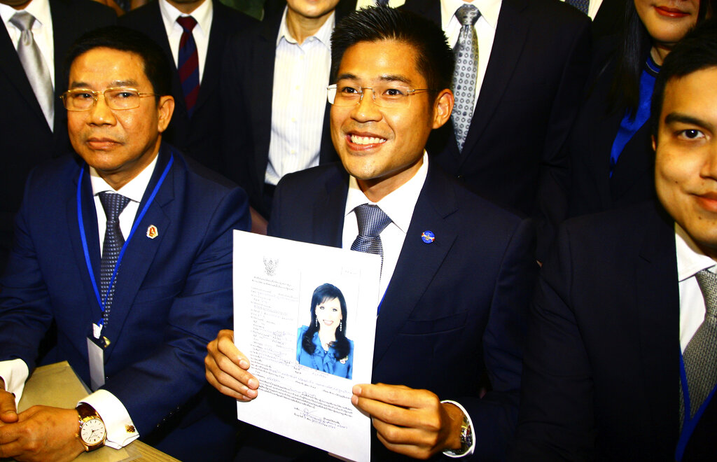 Leader of Thai Raksa Chart party Preecha Pholphongpanich holds a picture of Princess Ubolratana at the Thailand election commission in Bangkok on Friday, February. 8, 2019.