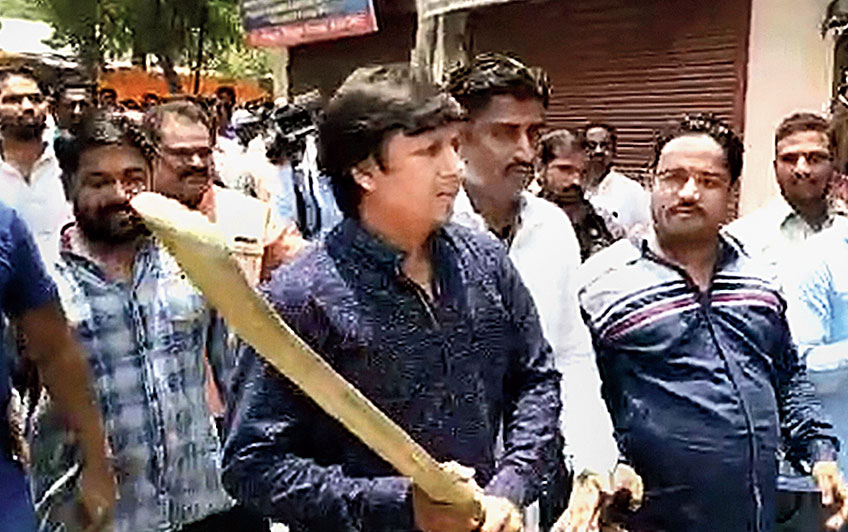 Footage shows Akash wielding the bat during a civic demolition drive in Indore on Wednesday