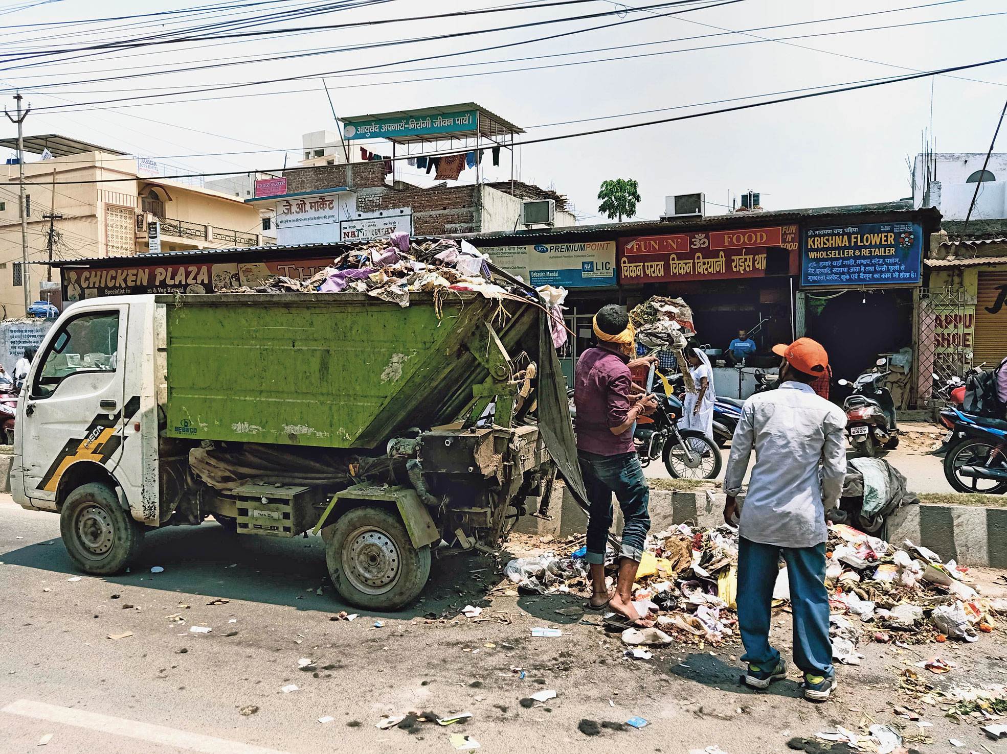 RMC employees collect garbage near Dangra Toli Chowk on Friday.