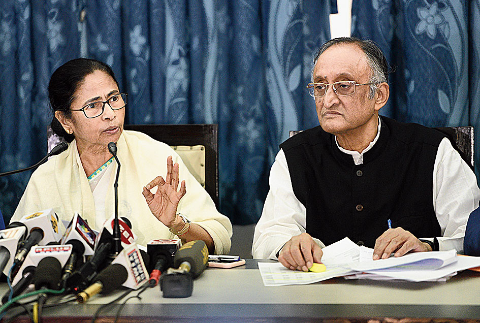 Mamata Banerjee with Amit Mitra in Calcutta on Monday.