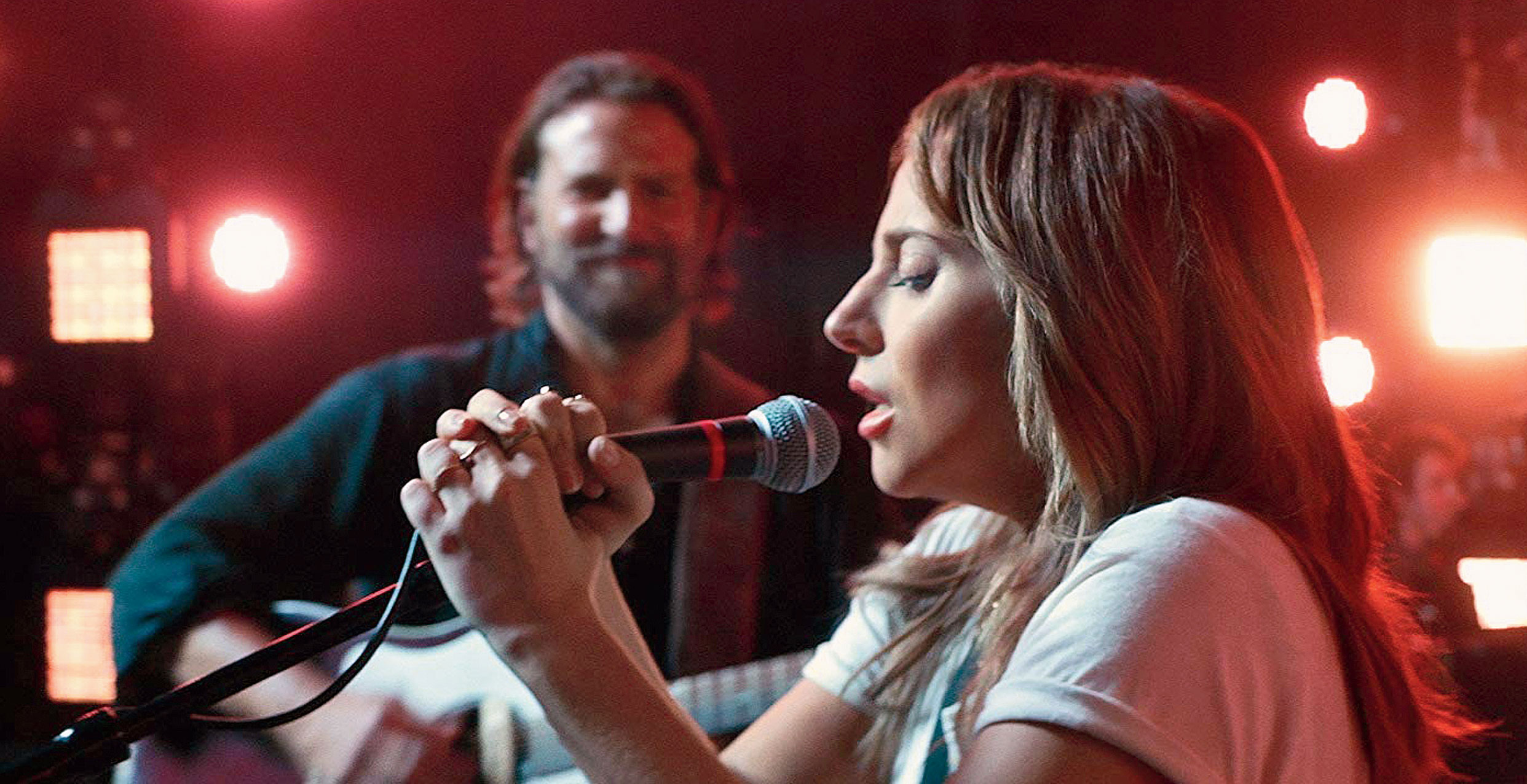 Bradley Cooper with Lady Gaga in A Star Is Born, releasing this Friday