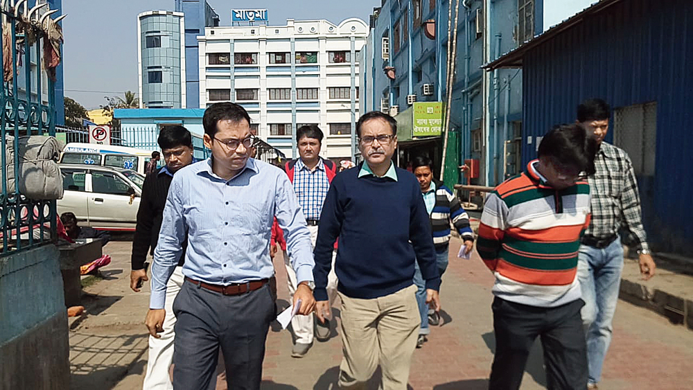 DM Mitra (left) and principal Mukherjee come out of the facility on Wednesday