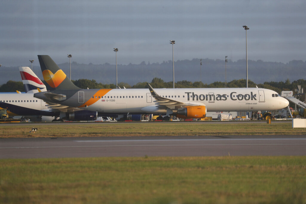 A Thomas Cook plane on the tarmac at Gatwick Airport in Sussex, England, on Monday, September 23, 2019. British tour company Thomas Cook has ceased trading, its four airlines will be grounded, and its 21,000 employees in 16 countries, including 9,000 in the UK, will lose their jobs