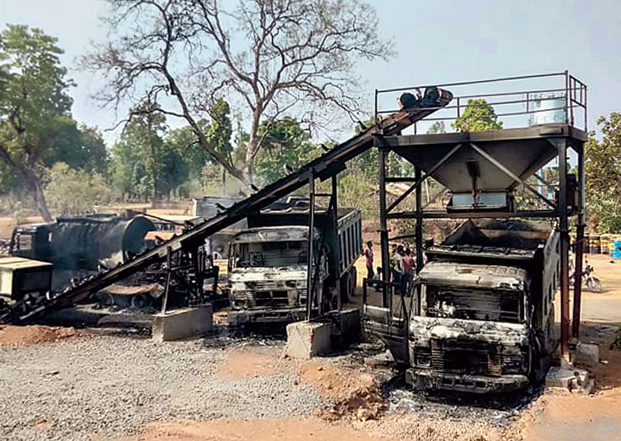 Charred vehicles that were blown up by Maoists in Gadchiroli district of Maharashtra on Wednesday.
