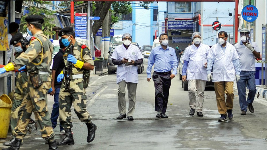 BSF personnel escort a central representative team to MR Bangur Hospital, where Covid-19 patients are treated, during the nationwide lockdown to curb the spread of coronavirus, in Kolkata