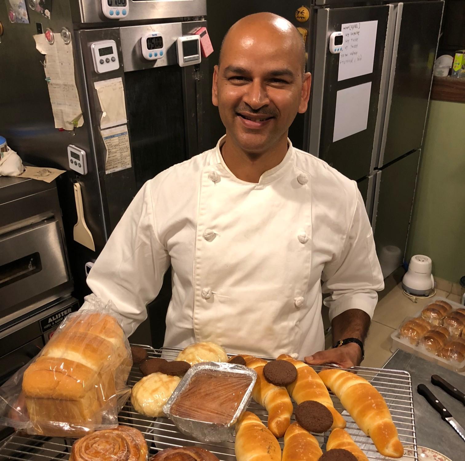 Master baker Tsunetaka Kawakami hired Rahul at Okayama Kobo, his well-known baking studio, for a year
