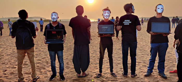 Vegan volunteers and activists participate in The Face of Truth, based on the 'Cube of Truth' model, holding up laptops playing slaughter videos and posters conveying awareness messages