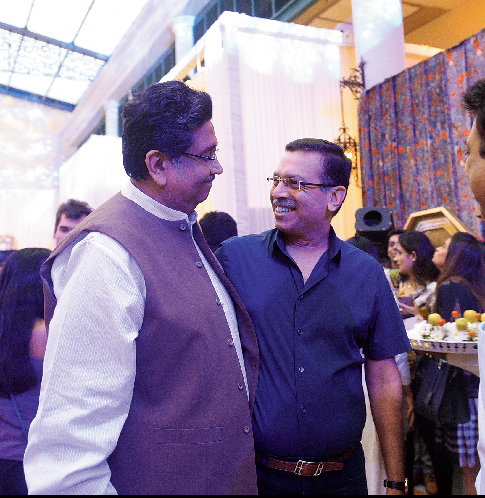 """Sanjiv Goenka dropped by at Wedding Diaries with his wife Preeti, son Shashwat and daughter-in-law Shivika on Saturday evening and was greeted by Harsh Neotia. """"Madhu always does a great job. So I enjoy coming here and looking at the stuff and my wife enjoys spending money!"""" said Sanjiv with a chuckle. """"When she conceives it, we are the butt of her mood swings. We have gone through that!"""" Harsh said with a smile, but was all praise for the venture. """"I think it is spectacular. Quite different. I think The India Story has a slightly more grunge element to it. This one has a little more oomph."""""""