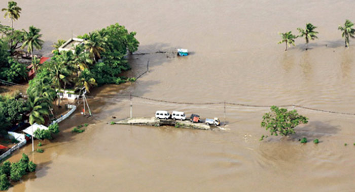 A flooded stretch in Kochi, Kerala, in August 2018. Some 36 million Indians are expected to face annual flooding by 2050. Climate refugees are not recognized under most international laws, thus rendering them ineligible for protection under many global legal frameworks.