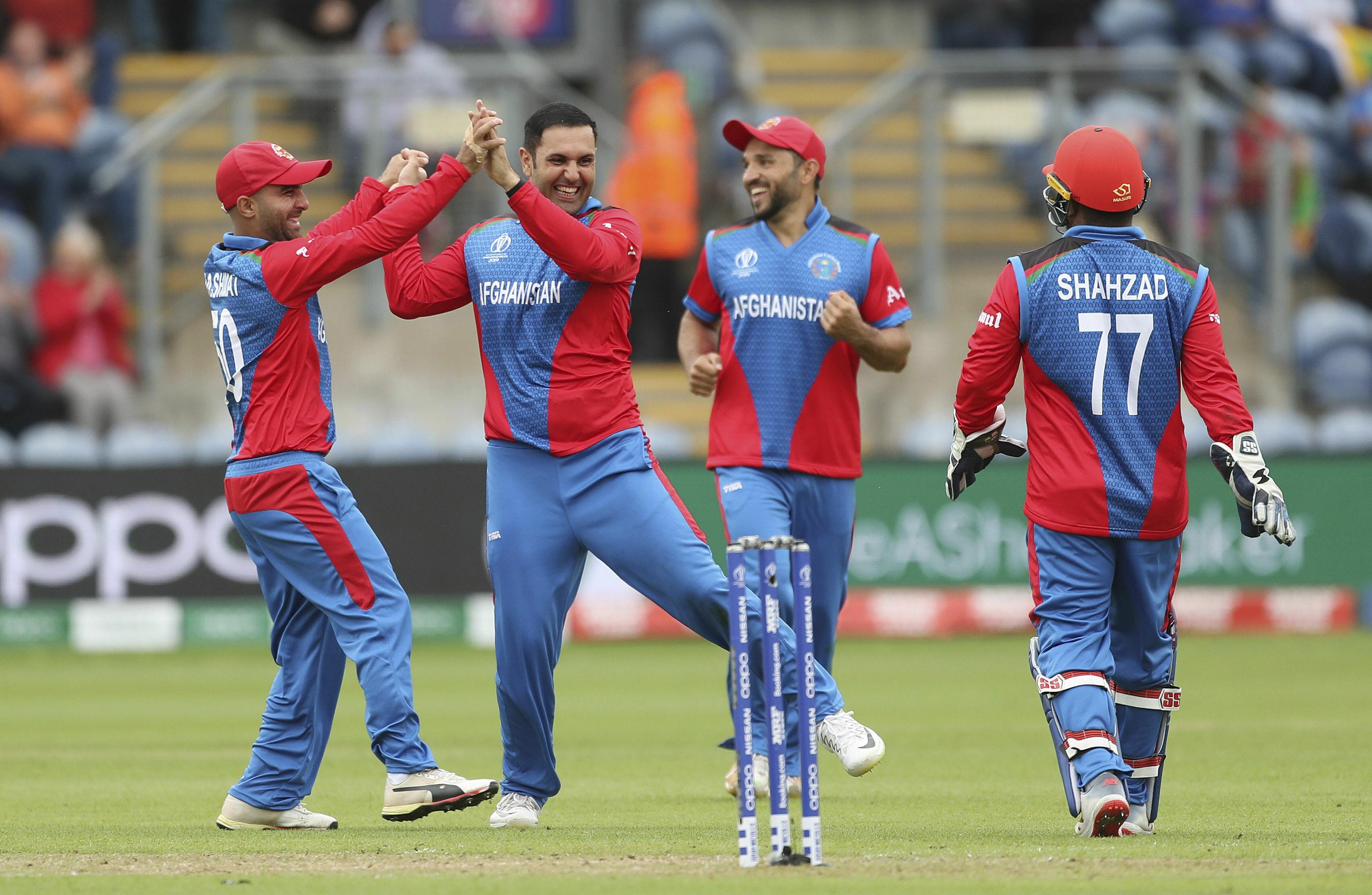 Afghanistan's Mohammad Nabi celebrates taking the wicket of Sri Lanka's Kusal Mendis at the Cardiff Stadium, Wales, on June 4.