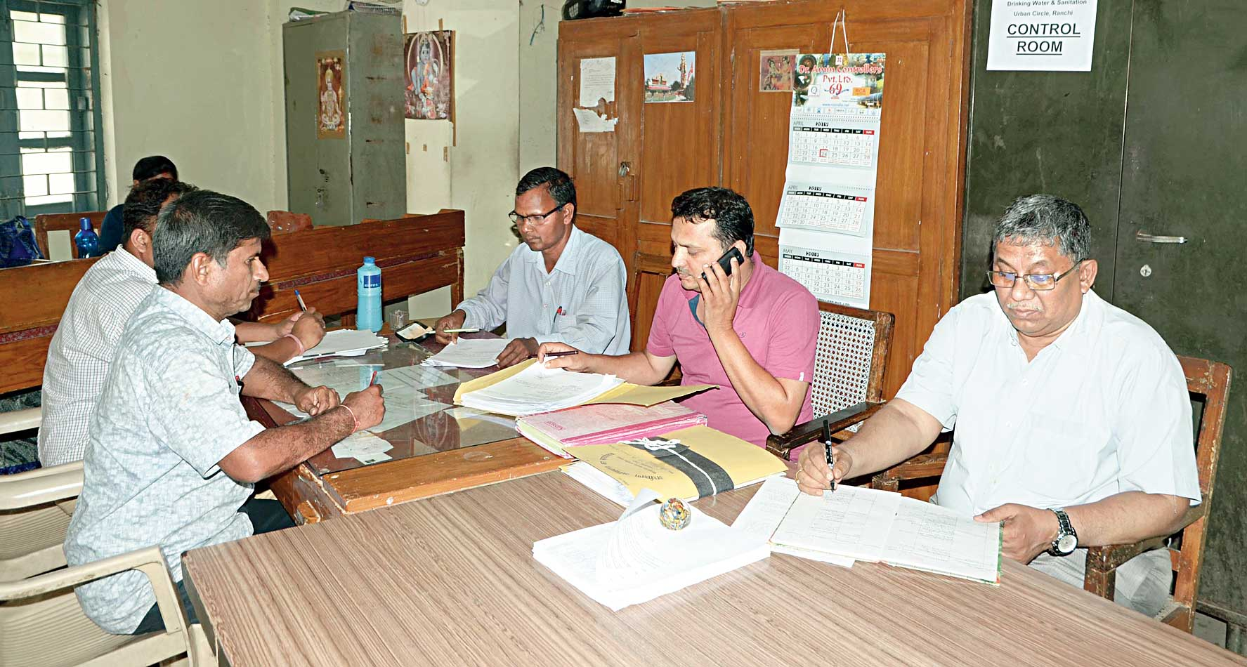 Staff of drinking water and sanitation department at the control room in Ranchi on Saturday.