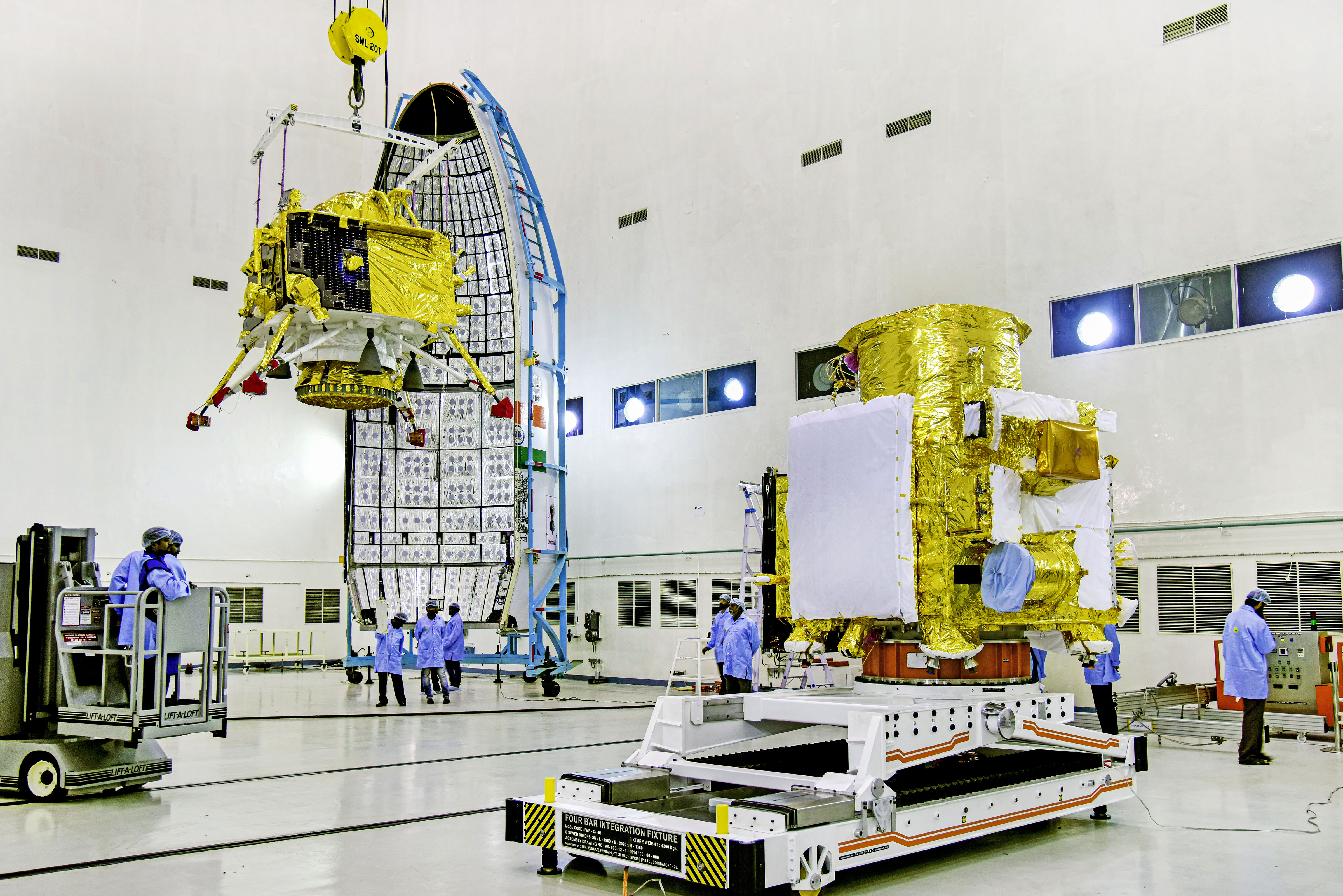 Officials carry out the hoisting of the Vikram Lander during the integration of Chandrayaan-2, at the launch center in Sriharikota on Thursday, July 11, 2019
