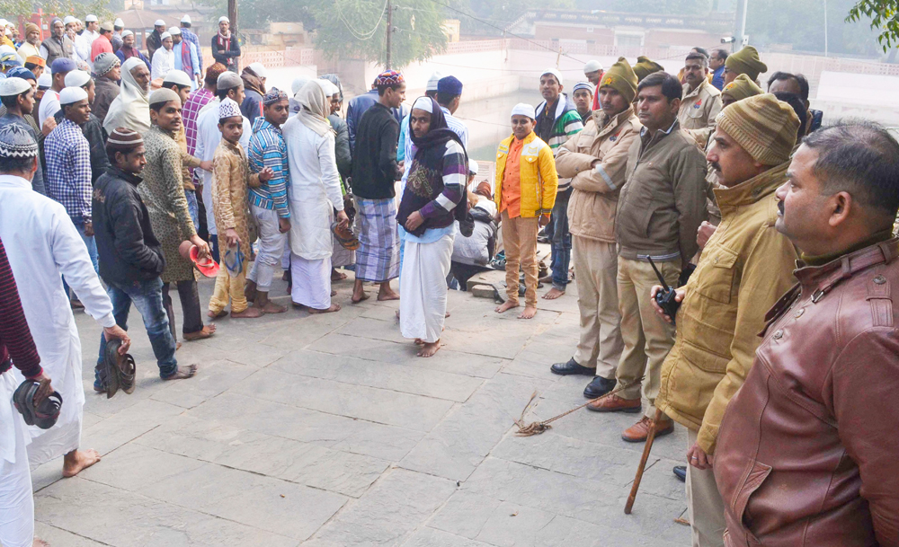 Police keep vigil in the view of anti-CAA protest calls outside a mosque after Friday prayers, in Varanasi, Friday, December 27, 2019.