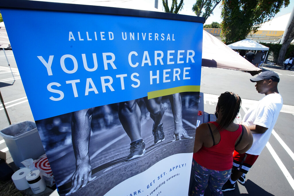 Job seekers fill out a application at a drive up job fair for Allied Universal on May 6, 2020, in Gardena, Calif. The extent of the economic damage from the coronavirus outbreak is being revealed in new U.S. government data.