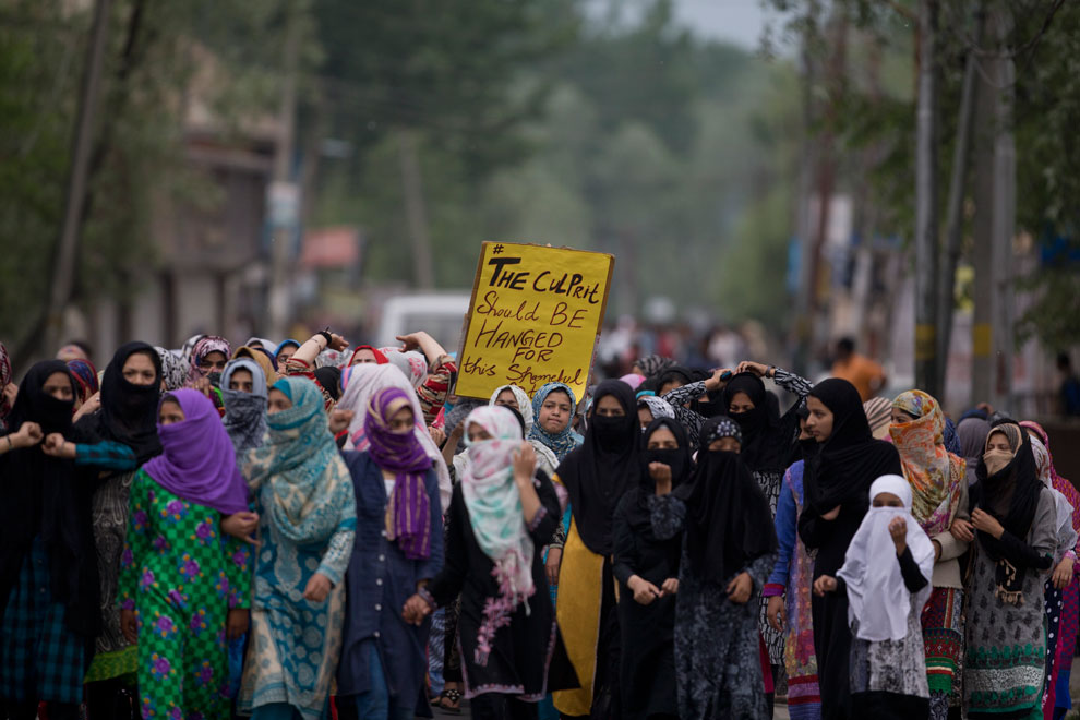 Kashmiri women participate in a protest against the alleged rape of a 3 year old girl from north Kashmir at Mirgund, outskirts of Srinagar on Monday, May 13, 2019.