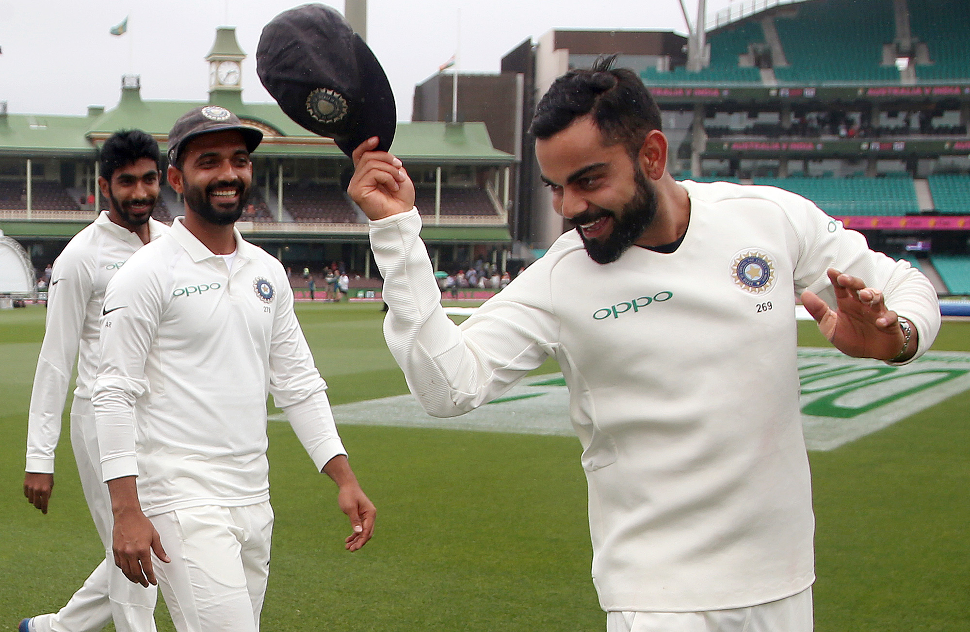 Virat Kohli tips his hat as he celebrates with teammates India's series win over Australia after play was called off on day 5 of their cricket test match in Sydney on Monday, January 7, 2019.