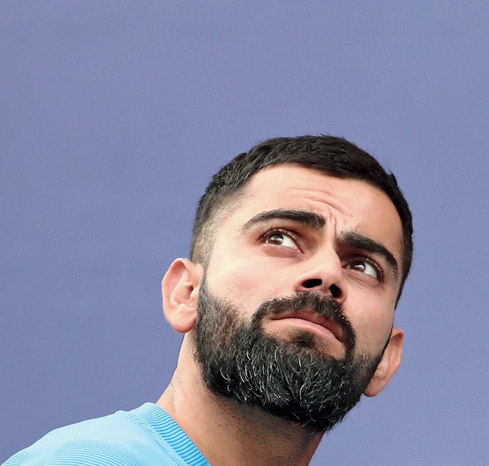 """Virat Kohli minutes after India lost the semi-final against New Zealand at Old Trafford in Manchester and were knocked out of the World Cup. """"It was a game of margins…. Forty-five minutes of bad cricket puts you out of the tournament. Difficult to accept it but New Zealand deserve it,"""" Kohli said"""