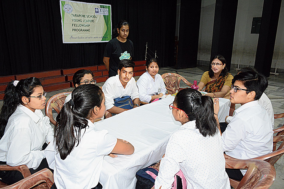 Students take part in a group discussion to qualify for Young Leaders Fellowship Programme at Tarapore School, Agrico, on Sunday.