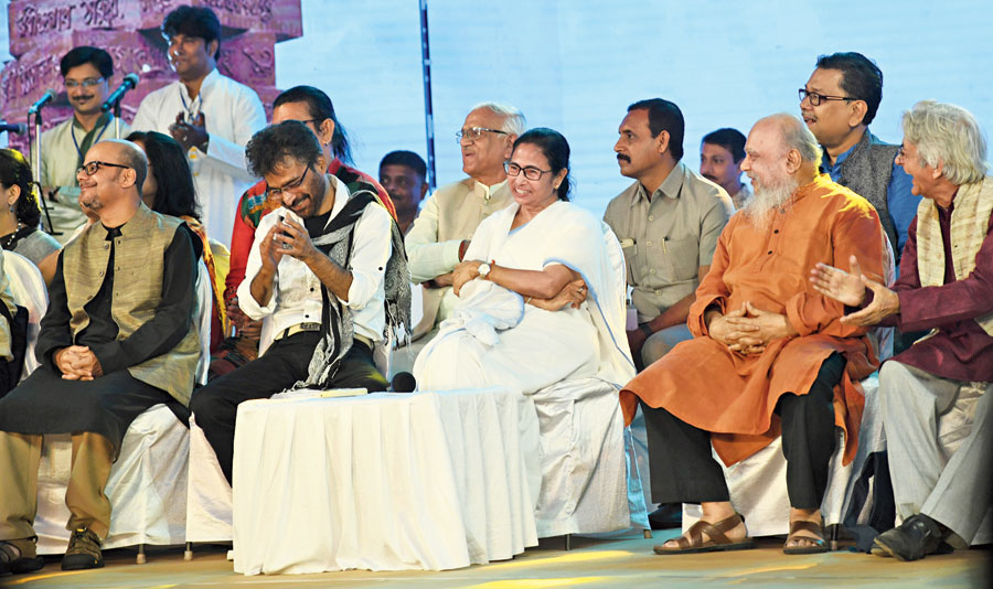 Chief minister Mamata Banerjee and other guests at a programme to mark International Mother Language Day  at Deshapriya Park on Friday.