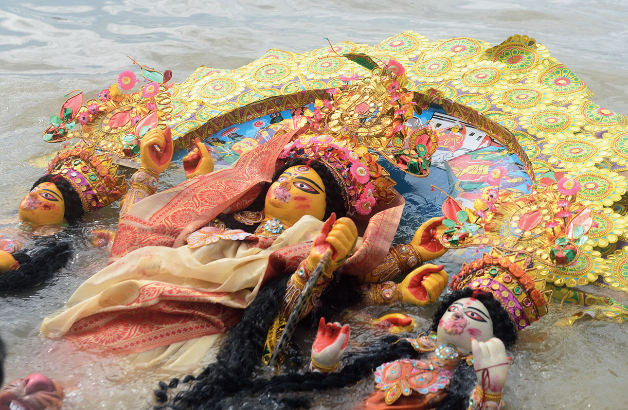 An idol after the immersion at Bagbazar ghat