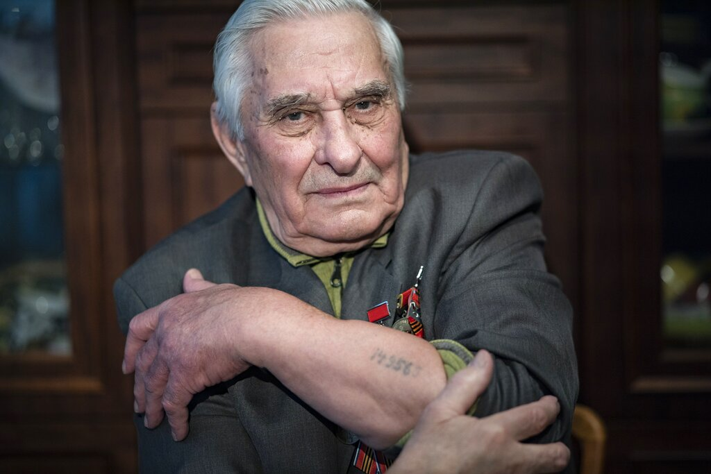 Yevgeny Kovalyov, 92, one of the Auschwitz concentration camp's survivors, shows the camp's identification number tattooed on his arm during an interview at his flat in Moscow, Russia.