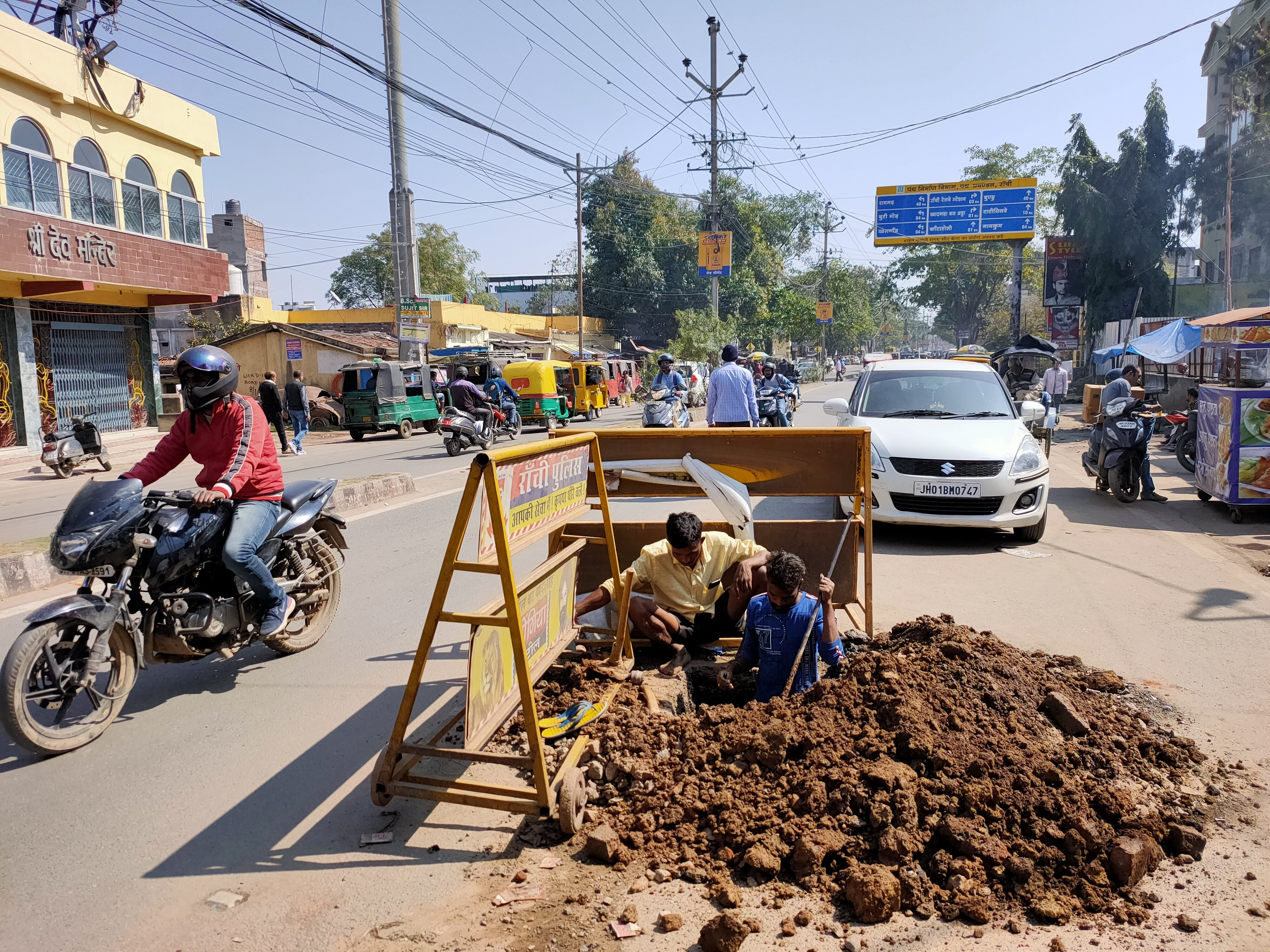 Workers repair a water pipeline at Dangra Toli Chowk in Ranchi on Thursday.