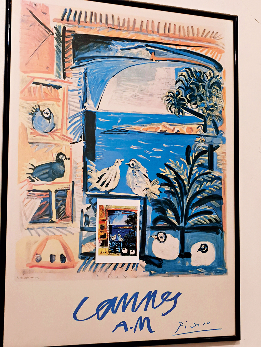 One of the faded posters a friend hangs on to is from Picasso's 1958 series of paintings of dovecotes against the blue sea at Cannes
