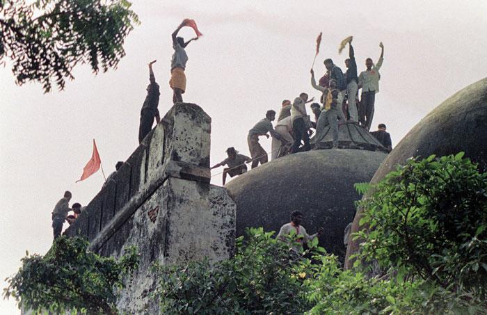 Kar sevaks standing atop Babri Masjid in December 1992