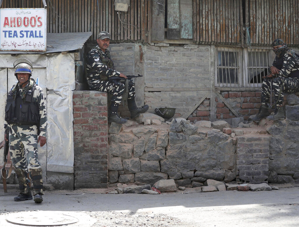 Paramilitary soldiers keep guard outside the main telephone exchange building in Srinagar, Kashmir, on Thursday, September 5, 2019