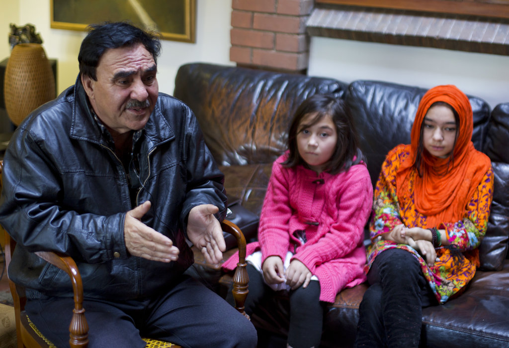 Mir Aman with his daughters Shahnaz (right) and Shakeela in Islamabad. Aman has no idea where his wife Maheerban Gul is being held.