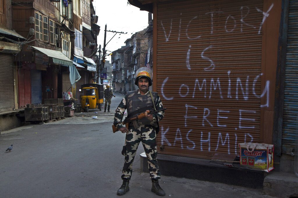 In this Tuesday, Sept. 13, 2016, file photo, a paramilitary soldier stands guard during curfew enforced to quell protestors in Srinagar, Kashmir