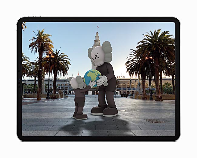 ARKit 4 introduces Location Anchors which allow developers to pin their AR experiences to a specific geographic coordinate — such as this KAWS sculpture which can be viewed through the Acute Art app