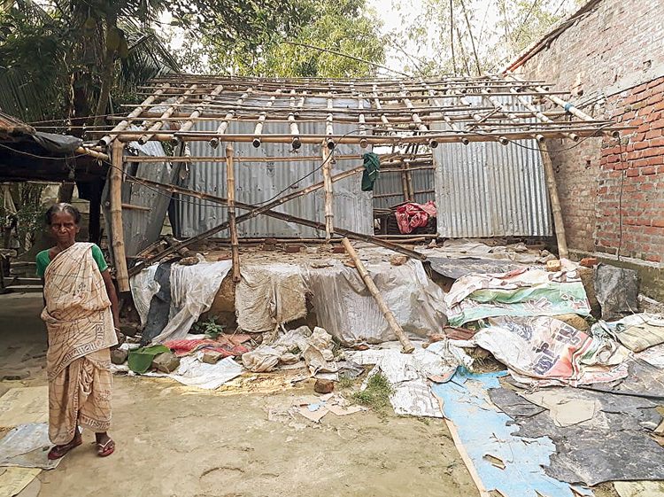 Kalyani Majhi in front of her damaged house at Majhida village in Nadia on Saturday.