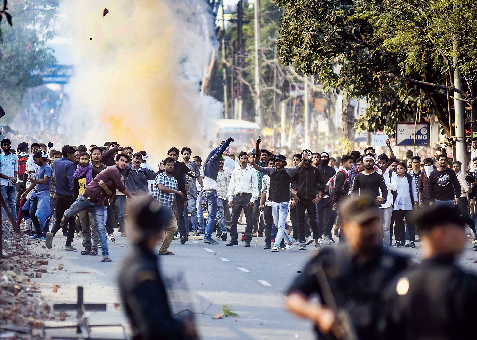 Protesters throw stones at the police in Guwahati on Wednesday during a march against the Citizenship Bill.
