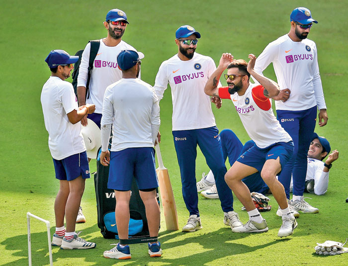 Virat Kohli shares a light moment with teammates during practice in Indore on Wednesday ahead of the first Test against Bangladesh.