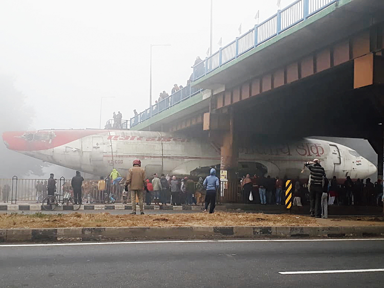 The aircraft stuck under the flyover in Durgapur early on Tuesday.