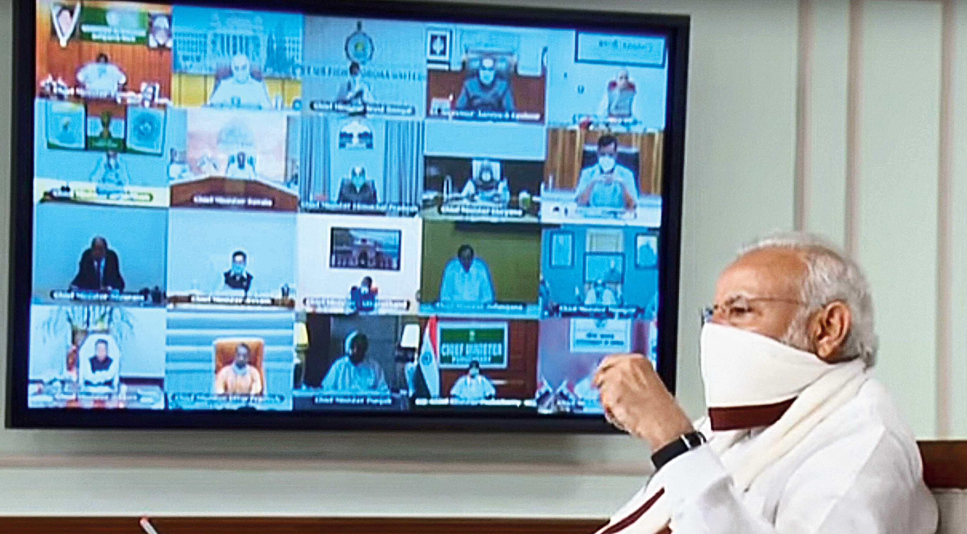 Prime Minister Narendra Modi wearing a protective mask chairs a meeting with chief ministers on the Covid-19 lockdown via videoconference in New Delhi on Saturday.