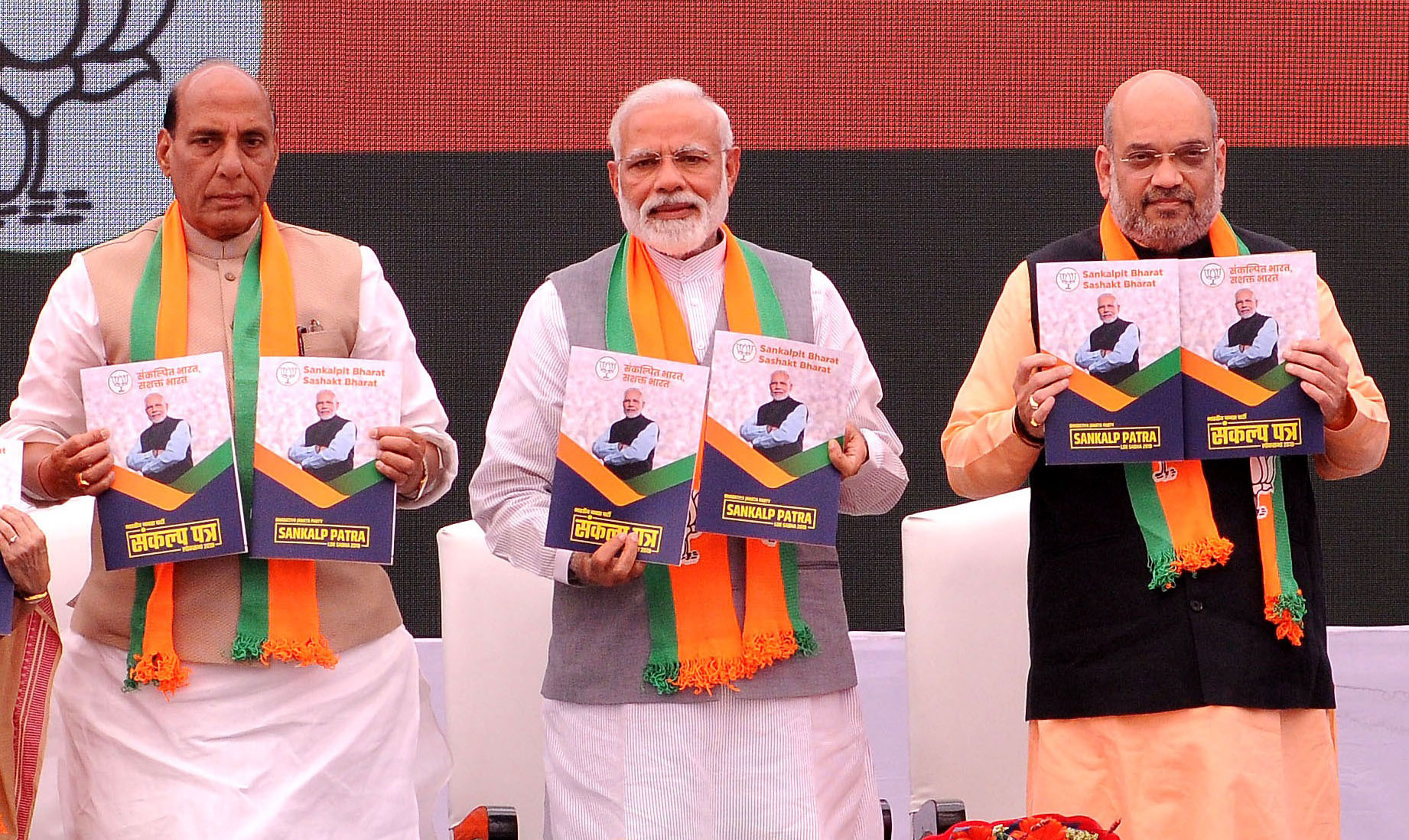 Prime Minister Narendra Modi, Amit Shah (right) and Rajnath Singh (left) during the release of BJP's manifesto (Sankalp Patra) for Lok Sabha elections 2019, in New Delhi on April 8, 2019.