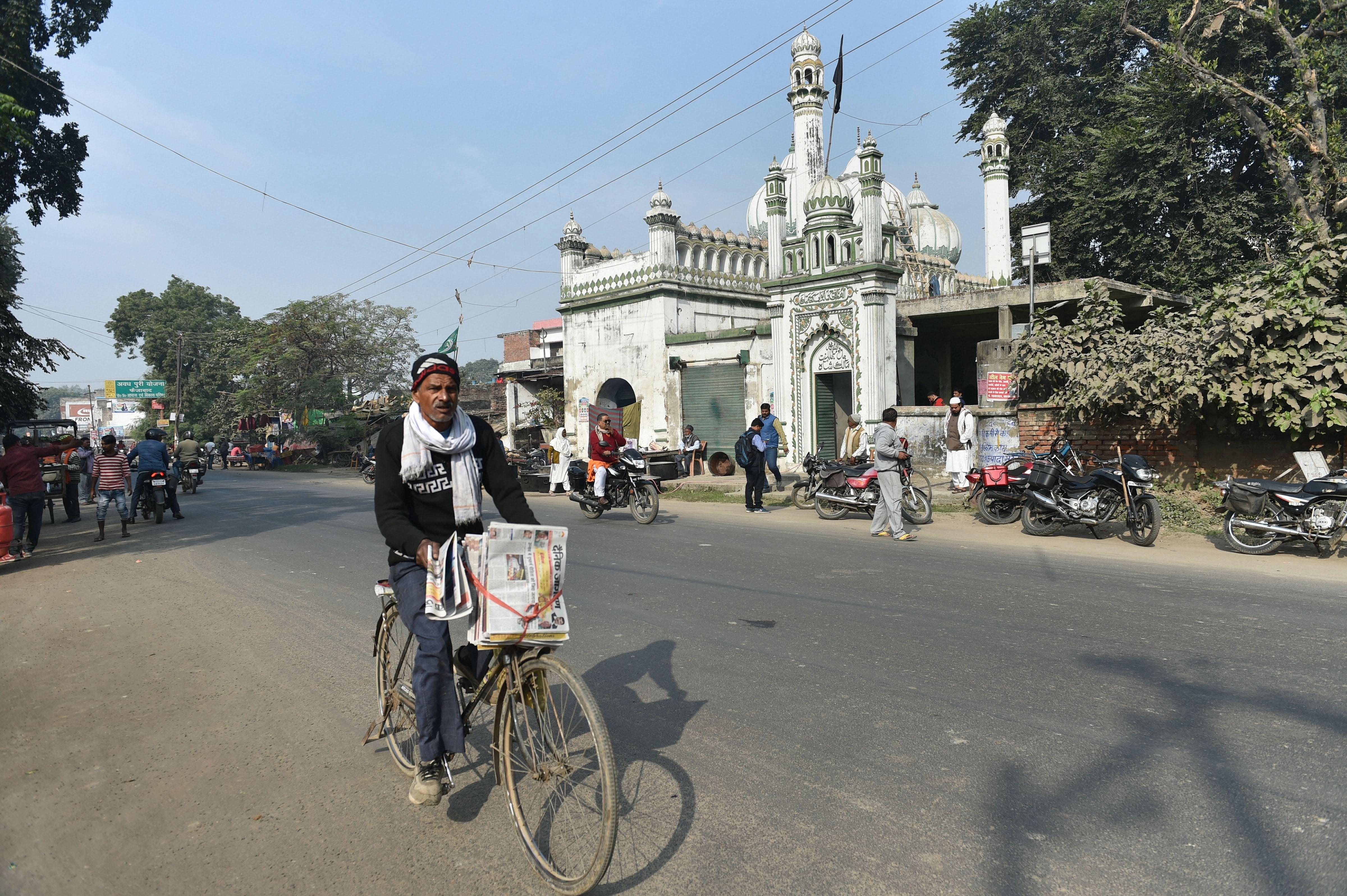 A cyclist rides past Jama Masjid Malik Shah, in Ayodhya, Friday, December 6, 2019