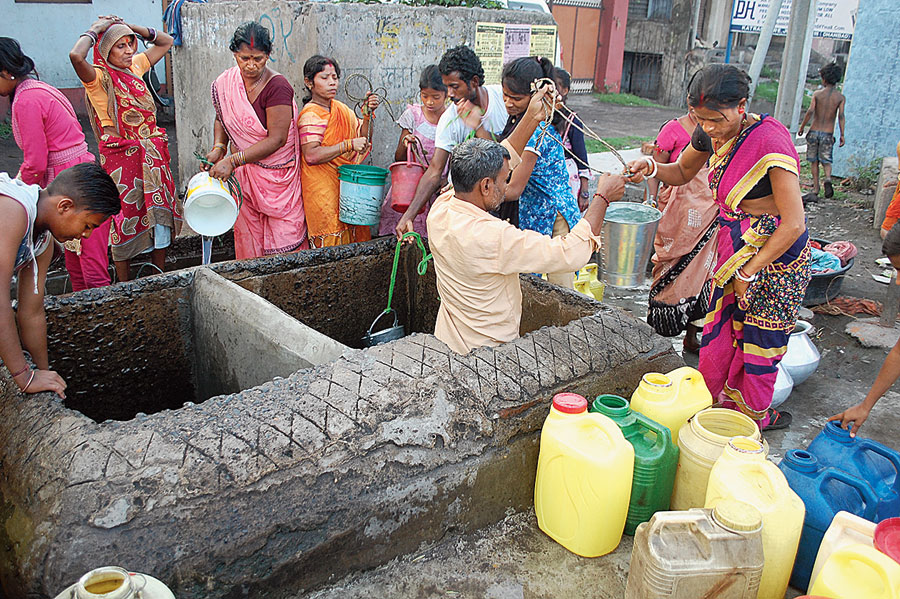 Residents collect water from a water tank at Jharia in Dhanbad on Friday.
