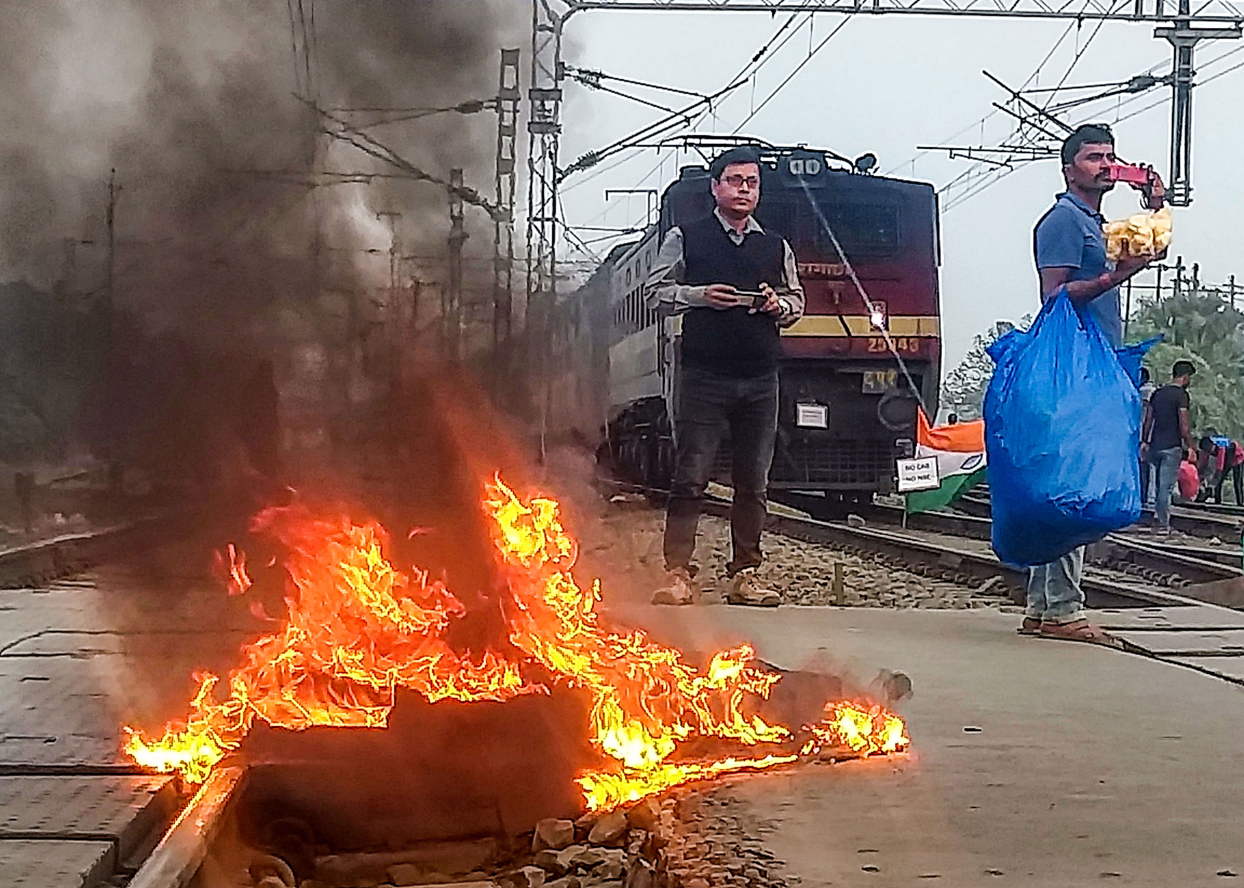 Fire near a railway track at Uluberia Station during an agitation in Howrah district on  Friday.