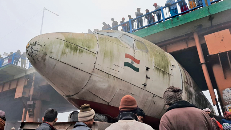 The aircraft stuck under the flyover in Durgapur early on Tuesday