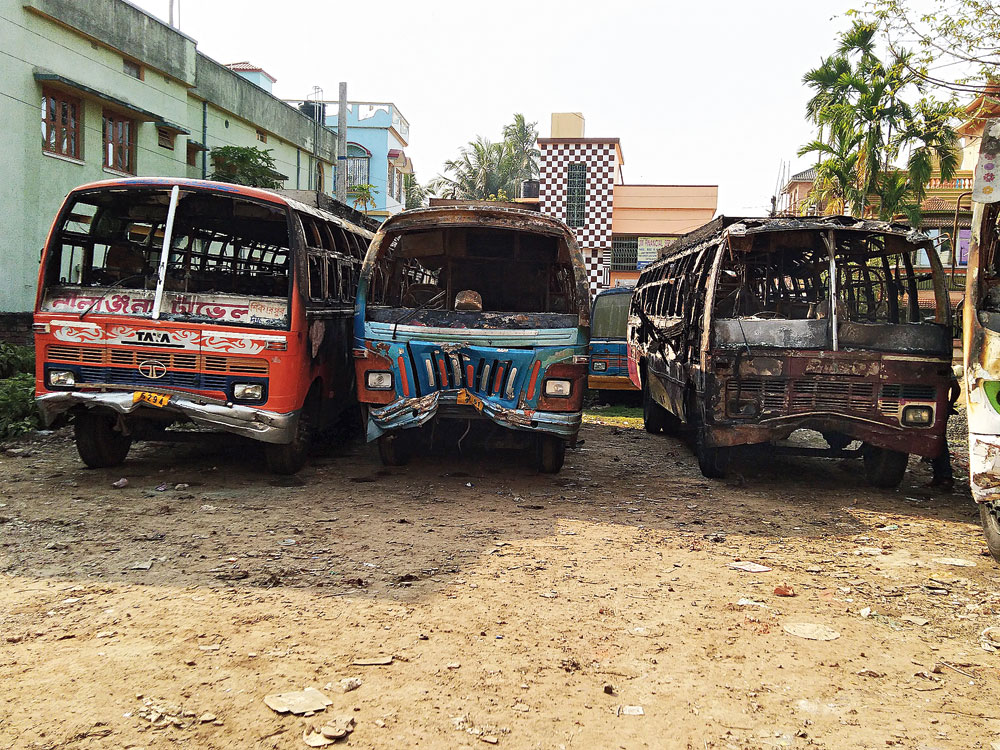 Some of the burnt buses at Krishnagar stand