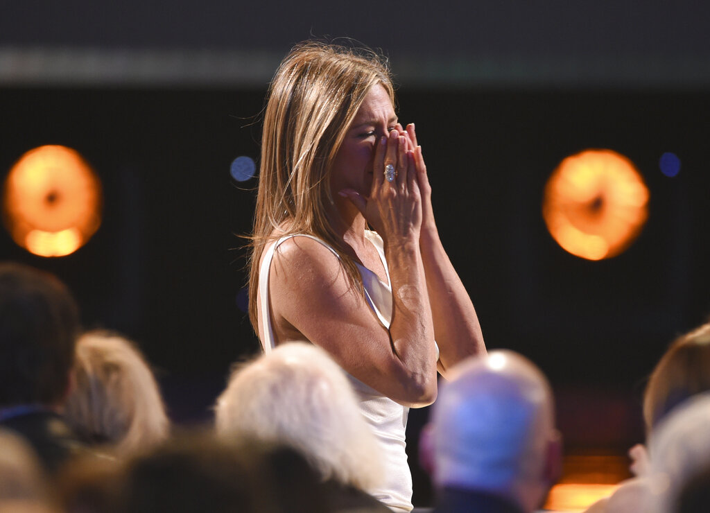Jennifer Aniston reacts before going on stage to accept the award for outstanding performance by a female actor in a drama series for