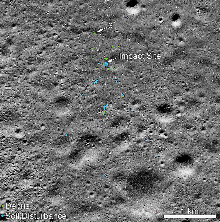 An undated picture released by Nasa on Tuesday shows a mosaic of the impact site of Chandrayaan-2 Vikram lander found by its Lunar Reconnaissance Orbiter. The blue spots show where the lander hit the moon surface and the green spots show the debris