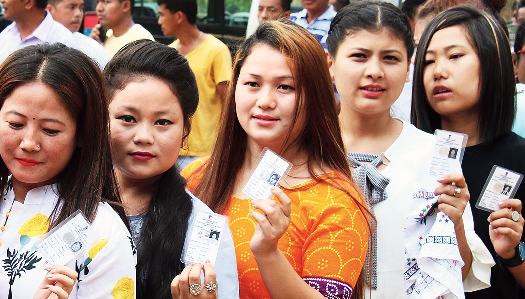 Girls with their voter cards at a polling booth at Sukna on Thursday.