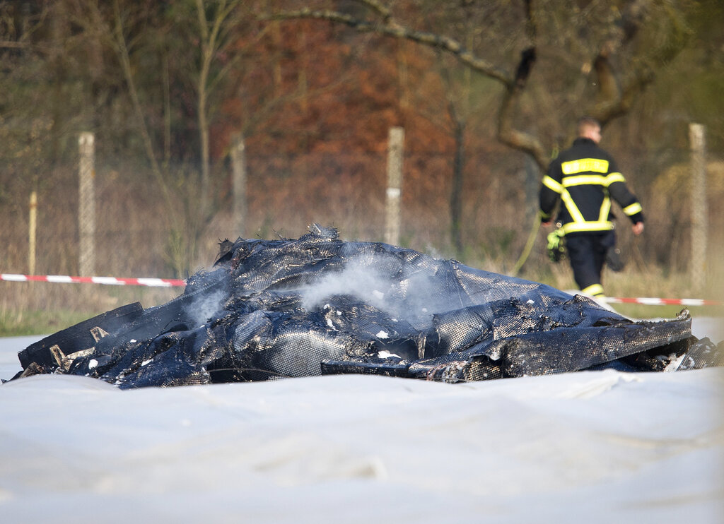The burnt-out debris of the aircraft lies on a field near the small airport of Egelsbach near Frankfurt on Sunday.