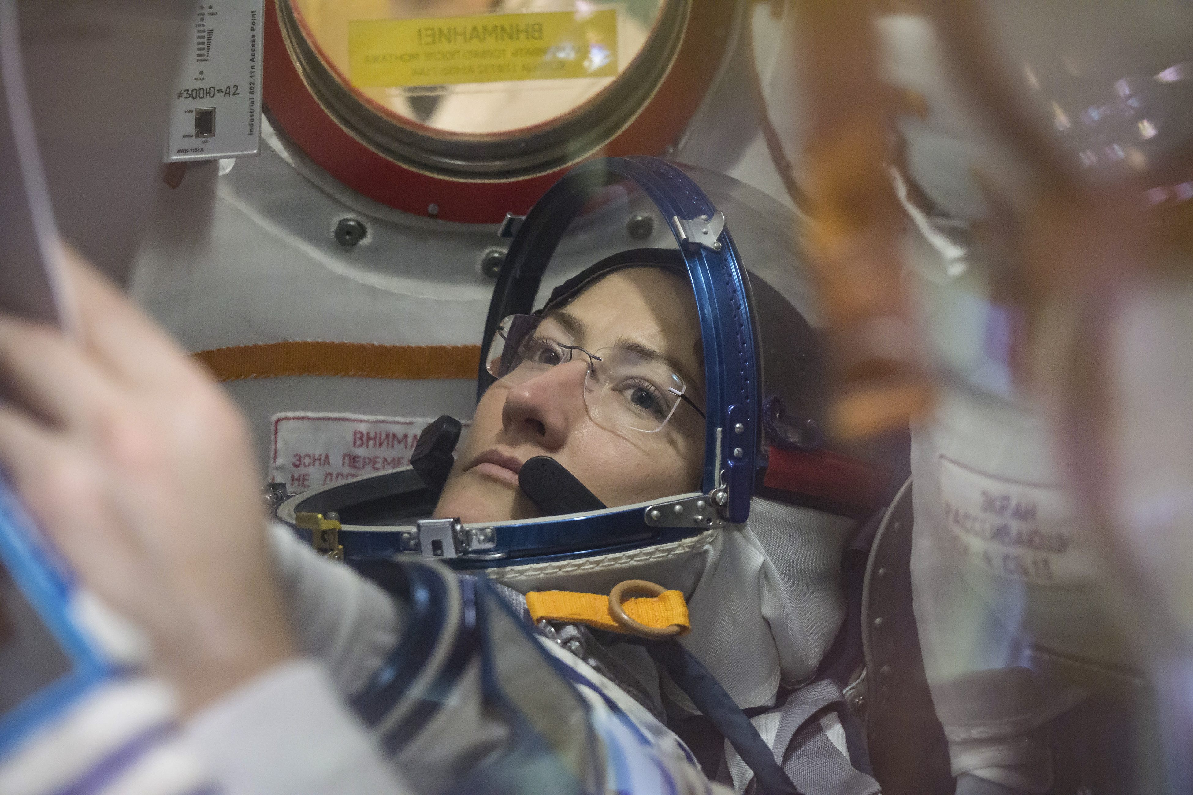 A photo provided by NASA of Christina Koch working inside the Soyuz MS-12 spacecraft at the Baikonur Cosmodrome in Kazakhstan.
