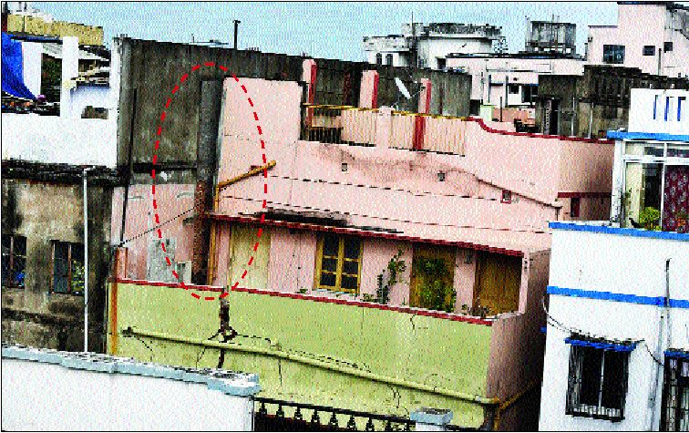A building in Bowbazar that has tilted because of water seepage into the East-West Metro Metro tunnel underneath. The portion marked in red shows the displacement.