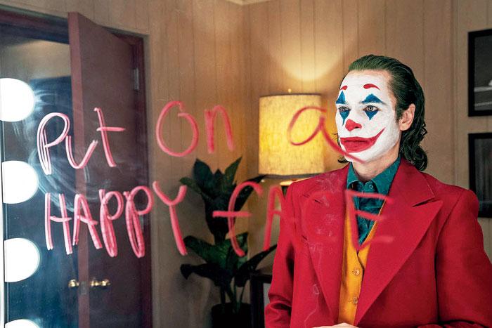 Joaquin Phoenix in and as Joker